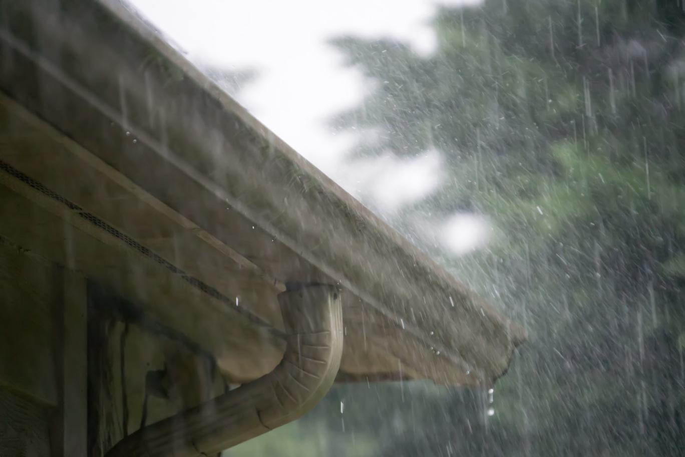 Rain dripping down seamless gutter system