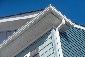 White gutters and blue siding