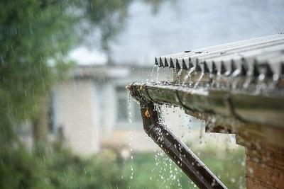 Rain dripping down gutter seams